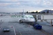 LAN-airlines-aircraft-with-tug-on-stand-Comodoro-Arturo-Merino-Benitez-International-Airport-Santiago-Chile-shot-through-window