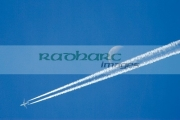 Two-engined-civilian-passenger-jet-leaves-contrails-on-blue-sky-with-moon-showing.