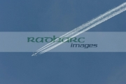 Four-engined-civilian-passenger-jet-leaves-contrails-on-blue-sky