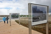 tourists-walk-around-photos-at-islas-malvinas-memorial-ushuaia-argentina