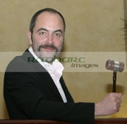 Jimmy-James-Nesbitt-with-auctioneers-gavel-at-the-Celebrity-Art-auction-for-WAVE-Trauma-Centre,-Beflast.