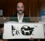 Jimmy-James-Nesbitt-with-one-Bonos-Peter-the-Wolf-prints-at-the-Celebrity-Art-auction-for-WAVE-Trauma-Centre,-Beflast.