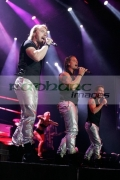 BELFAST,-UNITED-KINGDOM-_-MAY-25:-Ronan-Keating,-Keith-Duffy-Stephen-Gately-perform-with-Boyzone-at-the-Odyssey-Arena,-Belfast
