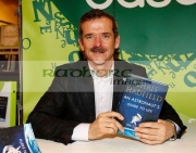 Canadian-Astronaut-Col-Chris-Hadfield-signs-copies-his-book-An-Astronauts-Guide-to-Life-on-Earth-at-Easons-Belfast-Northern-Ireland,-14th-January-2014.