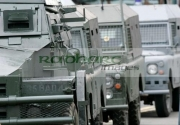 Former-British-Army-Humber-Pig-landrover-vehicles-RUC-landrover-on-the-set-Closing-the-Ring,-Belfast,-Northern-Ireland.