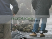 British-soldier-tends-fallen-injured-colleague-during-scene-on-the-set-Closing-the-Ring,-Belfast,-Northern-Ireland.