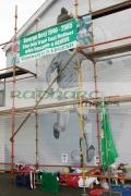 Repainting-George-Best-wall-mural-in-preparation-for-his-funeral,-East-Belfast,-Belfast,-Northern-Ireland.