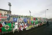 Tributes-for-George-Best-left-on-the-fence-Windsor-Park-soccer-stadium,-Belfast,-Northern-Ireland