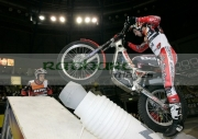 James-Dabill-from-Great-Britain-on-his-Beta-bike-in-action-with-helper-on-the-NGK-spark-plugs-obstacle-at-the-Belfast-round-the-Indoor-Trial-World-Championship,-won-by-Adam-Raga-from-Spain.