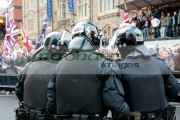 Group-PSNI-Police-Service-Northern-Ireland-riot-police-officers-stand-in-front-loyalist-protesters-at-the-Royal-Irish-Regiment-RIR-Homecoming-Parade-in-Belfast-on-September-02,-2008-in-Belfast,-Northern-Ireland.-The-parade,-which-passed-relatively-peacefully,-was-for-troops-returning-from-Iraq-Afghanistan.