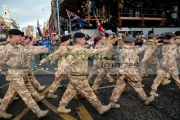 Royal-Irish-Regiment-soldiers-walk-past-loyalist-supporters-at-the-Royal-Irish-Regiment-RIR-Homecoming-Parade-in-Belfast-on-September-02,-2008-in-Belfast,-Northern-Ireland.-The-parade,-which-passed-relatively-peacefully,-was-for-troops-returning-from-Iraq-Afghanistan.