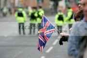 Supporter-with-union-flag-at-the-Royal-Irish-Regiment-RIR-Homecoming-Parade-in-Belfast-on-September-02,-2008-in-Belfast,-Northern-Ireland.-The-parade,-which-passed-relatively-peacefully,-was-for-troops-returning-from-Iraq-Afghanistan.