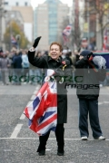 A-female-loyalist-supporter-with-union-flag-at-the-Royal-Irish-Regiment-RIR-Homecoming-Parade-in-Belfast-on-September-02,-2008-in-Belfast,-Northern-Ireland.-The-parade,-which-passed-relatively-peacefully,-was-for-troops-returning-from-Iraq-Afghanistan.