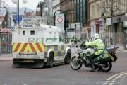 PSNI-police-officers-in-preparation-for-St-Patricks-Day-Parade,-at-St-Patricks-Day-Celebrations,-Belfast-City-Centre.