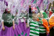Young-children-celebrate-in-St-Patricks-Day-Parade,-at-St-Patricks-Day-Celebrations,-Belfast-City-Centre.