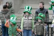 Family-await-the-St-Patricks-Day-Parade,-at-St-Patricks-Day-Celebrations,-Belfast-City-Centre.