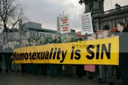 Religious-anti-gay-protestors-outside-the-Gay-Wedding-Shannon-Sickels-Grainne-Close-under-the-UKs-new-civil-partnership-laws,-Belfast-City-Hall,-Belfast,-Northern-Ireland