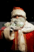 Man-dressed-as-santa-performs-on-stage-with-radio-microphone-mic-Belfast-Northern-Ireland