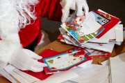 santa-opening-pile-childrens-christmas-letters-to-santa