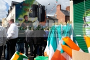 stall-selling-irish-flags-memoriabilia-on-Easter-Sunday-at-the-Easter-Rising-Commemoration-Falls-Road-Belfast-Northern-Ireland-UK