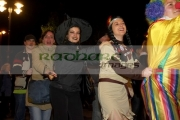 people-in-fancy-dress-do-the-conga-dance-through-the-crowd-in-guildhall-square-Halloween-Derry-Ireland