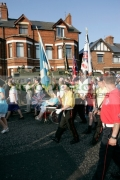 loyalist-band-with-flags-marching-on-crumlin-road-at-ardoyne-shops-belfast-12th-July-2005