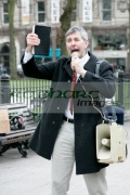 vertical-Bible-holding-protestor-delivers-fire-brimstone-preaching-to-paraders-on-St-Patricks-Day
