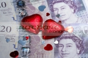 two-chocolate-hearts-decorations-on-pounds-sterling-cash