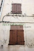 wooden-window-shutters-on-old-historic-stone-house-mont_louis-pyrenees_orientales-france
