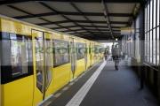 modern-yellow-u_bahn-train-sitting-at-station-platform-Berlin-Germany