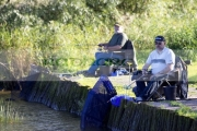 two-men-coarse-fishing-from-jetty-on-the-river-bann-county-antrim-northern-ireland