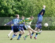 action-from-schoolboy-gaelic-football-player-kicking-the-ball-surrounded-by-opposing-players-including-one-diving-for-the-ball-belfast-county-antrim-northern-ireland
