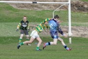 action-from-schoolboy-gaelic-football-player-kicking-ball-towards-goal-fending-off-opposing-player-belfast-county-antrim-northern-ireland