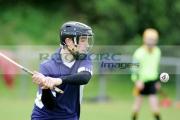 teenage-boy-wearing-protective-helmet-swings-hurling-bat-caman-at-hurley-ball-sliothar-during-practise-game