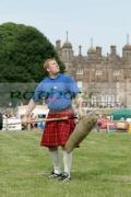 David-Barron-from-New-York-City-prepares-to-pitch-the-sheaf-at-the-Glenarm-Castle-International-Highland-Games-USA-v-Europe,-Glenarm,-County-Antrim,-Northern-Ireland.