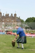Jamie-Barr-from-Fife-pitches-the-sheaf-at-the-Glenarm-Castle-International-Highland-Games-USA-v-Europe,-Glenarm,-County-Antrim,-Northern-Ireland.