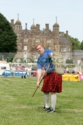 David-Barron-from-New-York-City-prepares-to-pitch-the-sheaf-at-the-Glenarm-Castle-International-Highland-Games-USA-v-Europe,-Glenarm,-County-Antrim,-Northern-Ireland.