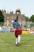 David-Barron-from-New-York-City-pitches-the-sheaf-at-the-Glenarm-Castle-International-Highland-Games-USA-v-Europe,-Glenarm,-County-Antrim,-Northern-Ireland.
