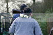 two-men-carrying-shotguns-broken-on-their-shoulders-back-to-safe-area-on-december-shooting-day,-county-antrim,-Northern-Ireland