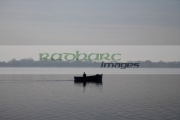 small-single-lone-fisherman-going-out-in-small-motorised-fishing-boat-on-lough-neagh-county-armagh-northern-ireland
