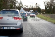 cars-waiting-in-traffic-due-to-road-resurfacing-on-country-road-in-the-republic-ireland