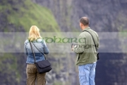male-blonde-haired-female-tourists-taking-photos-at-the-Cliffs-Moher,-County-Clare,-Republic-Ireland