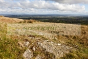 autumn-view-from-Slieve-Gallion-over-County-Tyrone-county-antrim-Northern-Ireland-with-rock-poking-through-in-the-foreground