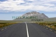 open-road-at-Errigal-mountain-donegals-highest-peak-against-blue-sky-between-dunlewey-letterkenny-white-quartzite-conical-cone-county-Donegal-Republic-Ireland