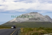 cars-on-road-to-Errigal-mountain-donegals-highest-peak-against-blue-sky-between-dunlewey-letterkenny-white-quartzite-conical-cone-county-Donegal-Republic-Ireland