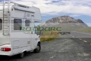 touring-camper-van-at-the-side-the-road-next-to-Errigal-mountain-donegals-highest-peak-against-blue-sky-between-dunlewey-letterkenny-white-quartzite-conical-cone-county-Donegal-Republic-Ireland
