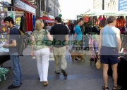 people-including-couple-walking-through-market-stalls-in-Galway-city-county-Galway-Republic-Ireland