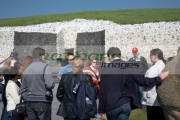 tour-guide-with-group-tourists-outside-the-megalithic-passage-tomb-newgrange,-county-meath,-republic-Ireland