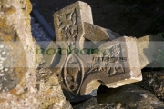 broken-celtic-cross-in-the-remains-Saint-Colemans-abbey-16th-century-church-at-Ardboe-county-tyrone-northern-ireland
