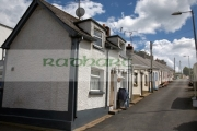 the-row-seamount-row-traditional-fishing-cottages-with-gable-wall-on-hill-in-courtown-harbour